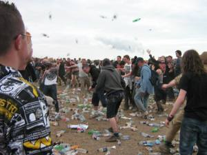 Bored, wet and hungover. The masses take to throwing shit!